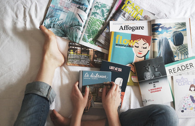 Canva   Flay Lay Of Woman Reading Magazines On Bed Sml