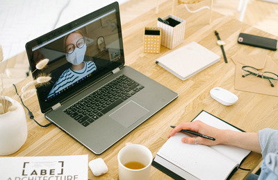 Canva   Woman Having Video Call In Home Office (1)