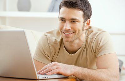 Casual Man At Computer